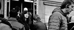 Shared moment. (Baz 120) Tags: candid candidstreet candidportrait city contrast street streetphoto streetcandid streetportrait strangers rome roma ricohgrii women europe monochrome monotone mono noiretblanc bw blackandwhite urban life portrait people provoke italy italia grittystreetphotography faces decisivemoment