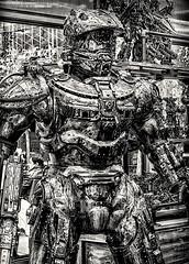 Man of Medieval Times (nrhodesphotos(the_eye_of_the_moment)) Tags: dsc99123001084 wwwflickrcomphotostheeyeofthemoment theyeofthemoment21gmailcom metal armor kiosk bryantpark nyc outdoors manhattan blackandwhite monochrome medieval