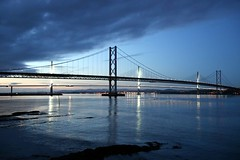 The Old & The New At Dusk (crashcalloway) Tags: bridge bridges forthroadbridge firthofforth water sky dusk clouds southqueensferry dalmeny shore sea scotland scottish bluehour