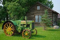 Hythe Visitor Center (MIKOFOX ⌘) Tags: proviaasbase learnfromexif canada xt2 cabin roadtrip showyourexif mikofox logcabin july summer fujifilmxt2 tractor alberta johndeere xf18135mmf3556rlmoiswr explored