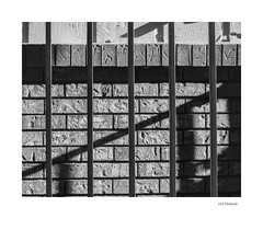 Jailhouse (agianelo) Tags: metal bar brick wall shadow line abstract texture monochrome bw bn blackandwhite