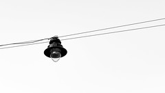 Lucifer (Konrad Niechwiej) Tags: sky black white monochrome lantern hanging light cracow krakow lesser poland karmelicka