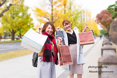 Young female friends shopping together in urban city (yumehana) Tags: 2024years 2529years adult adultsonly asia asianandindianethnicities capitalcities carefree casualclothing cheerful city citylife citystreet coatgarment consumerism day enjoyment fashion friendship fun happiness horizontal japan japaneseethnicity leisureactivity lifestyles lookingatcamera marunouchi millennialgeneration nature onlyjapanese onlywomen outdoors people photography shopping shoppingbag straighthair street threequarterlength togetherness tokyojapan twopeople walking weekendactivities women youngadult youngwomen autumn autumnleaves