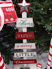 Have Yourself A Merry Little Christmas. (dccradio) Tags: lumberton nc northcarolina robesoncounty indoor indoors inside walmart retail store decorations christmas holiday christmasdecorations holidaydecorations december thursday thursdayevening evening goodevening samsung galaxy smj727v j7v cellphone cellphonepicture 89 pricetag price star sign words text pine pinebranches holidaytree christmastree red white striped greenery