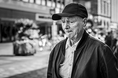 The Thinking Cap (Leanne Boulton) Tags: urban street candid portrait portraiture streetphotography candidstreetphotography candidportrait streetportrait streetlife old man male face eyes expression mood feeling thinking pensive cap tone texture detail depthoffield bokeh naturallight outdoor light shade city scene human life living humanity society culture lifestyle people canon canon5dmkiii 70mm ef2470mmf28liiusm black white blackwhite bw mono blackandwhite monochrome glasgow scotland uk