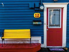 Yellow Bench (Karen_Chappell) Tags: yellow blue red door house home bench seat jellybeanrow stjohns downtown atlanticcanada avalonpeninsula eastcoast nfld newfoundland city urban wood wooden paint painted mail mailbox post architecture bright colourful colours colour color colors multicoloured 12 number sign window white trim clapboard siding canonef24105mmf4lisusm