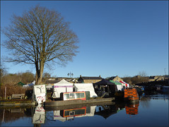 December canal scene. (Country Girl 76) Tags: skipton canal basin boats christmas market reflections water sky tree