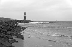 Warnemünde - extreme low tide at western breakwater (eucalli) Tags: eucalli einfarbig bw blackandwhite blackwhite monochrome monochrom mecklenburgvorpommern maritim mecklenburg ostsee ostseebad warnemünde warnemündestrand wave welle wellen rostock norddeutschland mvp nikon nikondigital nikonfx nikonfxshowcase tamron d810 baltic balticsea surfer breakwater