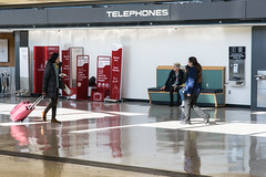 19-8456 (George Hamlin) Tags: virginia chantilly washington dulles international airport telephones terminal building saarinen iad travelers luggage people reflection george hamlin photography photodecor