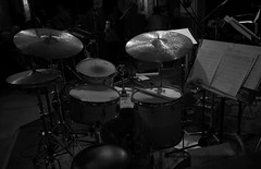 Waiting to Begin (Anthony Mark Images) Tags: stage drums cymbals drumkit sheetmusic drumsticks concert thejazzroom jazzmusic music monochrome blackandwhite microphones piano huetherhotel waterloo ontario canada nikon d850 flickrclickx