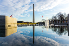 A beautiful morning at the WWII Memorial. (erikcoxphotography) Tags: washingtondc washingtonmonument ww2memorial reflection clouds