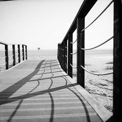 Hangin' Shadows (Manuel&TheSea) Tags: monochrome mediumformat filmphotography film ishootfilm tlr analoguephotography analogue bw iso125 homedevelop rodinal125 rodinal ilfordfilm ilford fp4 ilfordfp4 somberthiotparis luxoflex atos2 6x6 squareformat vintagecamera 50scamera beach seascape bridge shadows ropes