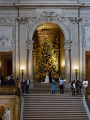 Bride and Groom Get Turn With Christmas Tree (mahteetagong) Tags: sanfrancisco cityhall architecture wedding baroque nikon d80 35mmf18 mezzanine photography christmastree