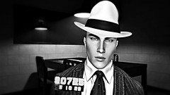 """"""" Capone """" (maka_kagesl) Tags: secondlife sl game gaming games virtual videogame videogames photography portrait photo picture pic pose posing avatar avi snap snapshot screenshot bw blackwhite mafia chicago mob mobster mobsters art artist mafioso lacosanostra cosanostra crime criminal fedora hat grey police mugshot detective"""