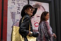 Golden Girl (Silver Machine) Tags: bath somerset streetphotography street candid woman walking shopping handbag poster advertisement fujifilm fujifilmxt10 fujinonxf35mmf2rwr