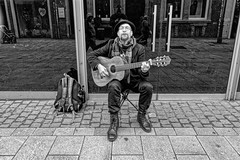 THE GUITARIST (NorbertPeter) Tags: man street people portrait city urban outdoor music hat guitar düsseldorf germany spontaneous streetphotography streetportrait streetmusician monochrome sony rx100 blackandwhite bw musician