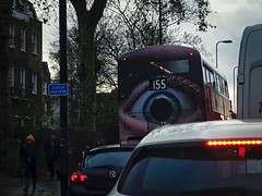 Eye (sixthland) Tags: blipfoto cameraphone bus stockwell advertisement 155 traffic