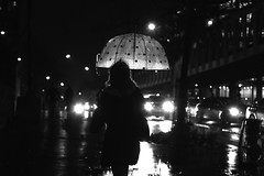 Under the light (pascalcolin1) Tags: paris13 femme woman pluie rain nuit night lumière light parapluie umbrella phares voitures cars photoderue streetview urbanarte noiretblanc blackandwhite photopascalcolin 50mm canon50mm canon