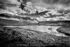 The locan of Loch Uidh na a-larna with Quinag in the background (john@johnrobertsimages.co.uk) Tags: rock gleannleireag landscape calm nature reflection outdoor lake hill sea unitedkingdom britain blackandwhite photography sky uk dramatic waterresources background sunset stockphotography locan uidh alarna mono quinag mountain bodyofwater monochromephotography shore loch naturallandscape highland photograph scotland monochrome travel cloud winter lakedistrict scenery water moody mountainrange wilderness nedd