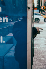 Size Matters (Creekside Photog) Tags: newyork hellskitchen streetphotography cigarette finger man smoking blur grain