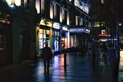 . (Johnbasil1) Tags: rain colours highlights shadow candid cityscape city urban cold mood reflection glow contrast dark night