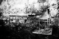 The teachers desk (vale0065) Tags: table tafel desk bureau stoel chair cave cellar kelder old oud wall muur steen brick blackwhite bw zwartwit monochrome monochroom abandoned verlaten urbex urban slovenia slovenië