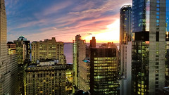 Sunset (Yuri Dedulin) Tags: city architecture skyscraper cityscape dusk office business modern finance sunset sky apartment horizontal colorimage unitedstatesofamerica americanculture selectivefocus downtowndistrict builtstructure urbanskyline tallhigh nopeople newyorkstate newyorkcity theamericas northamerica outdoors officebuildingexterior imagefocustechnique financialdistrict buildingexterior yuridedulin newyourk ny nyc