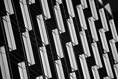 Decorative vanes on Kirby Grove building (infrared) (dr_marvel) Tags: ir infrared houston tx texas upperkirby kirbygrove architecture blackandwhite monochrome levypark