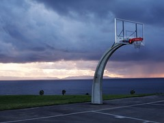 As The Storm Approaches The Basketball Court (Joey Z1) Tags: lonebasketballcourt approachingstorm nearingsunset urbanscene stormclouds emptybasketballcourt viewofthepacificocean catalinaisland lalife sanpedroareaoflosangeles atmosphericscene polychromatic photojournalism pentax645z photobyjoeyzanotti