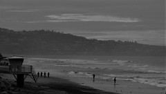 Fishing and Walking (Rand Luv'n Life) Tags: odc our daily challenge black friday torrey pines state beach san diego county california ocean waves surf fishermen four abreast walking lifeguard tower hill ridge clouds monochrome blackandwhite outdoor