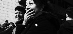 Private joke I was never privy to. (Baz 120) Tags: candid candidstreet candidportrait city contrast street streetphoto streetcandid streetportrait strangers rome roma ricohgrii europe women monochrome monotone mono noiretblanc bw blackandwhite urban life portrait people provoke italy italia grittystreetphotography faces decisivemoment