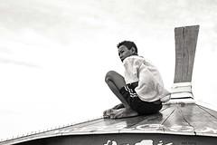 Boat Boy (Reto Togni Pogliorini) Tags: boat ride thailand boy boatboy portrait local guy blackandwhite nikon d700 50mm