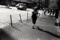 Running Woman (David Davidoff) Tags: people street life woman shadow leicam6ttl summaron35mmf35goggles fomafilm blackwhite