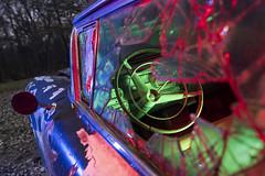Abandoned Cadillac in RGB (Notley Hawkins) Tags: httpwwwnotleyhawkinscom notleyhawkinsphotography notley notleyhawkins 10thavenue night nocturne moonlight cadillac brokenwindow carwindow missouri boonecountymissouri outdoors auto abandoned bluelight lightpainting light car redlight greenlight rgb 2019 steeringwheel wheel drivingwheel december cracks crackedwindow
