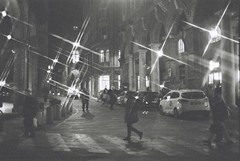 Bologna (goodfella2459) Tags: nikonf4 afnikkor50mmf14dlens ilfordsuperxp2400 35mm c41 blackandwhite film analog night city streets road pedestrians bologna italy lights filter crossstarfilter lensfiltersgroup bwfp