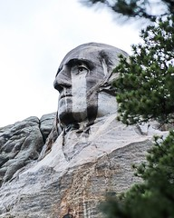 crying Mr. Washington (Yuki (8-ballmabelleamie)) Tags: mountrushmorenationalmemorial usnationalpark stonesculpture monument landmark carving rain damp portrait tourism roadtrip southdakota