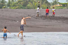 a time to play (Pejasar) Tags: guatemala colorful boy beach pacific ocean coconutball soccer boys throw reach ball splash