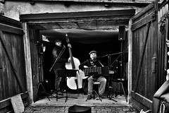 garageband (laird.lothar) Tags: garage streetphotography black dark musicians band streetmusic advent quedlinburg concert germany people man guitar bass