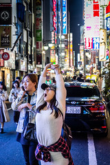 Do we have to party? (Piotr_Lewandowski) Tags: kabukicho shinjuku tokyo japan nippon asia street streetphotography candid couple young people urban cityscape city light lights urbex night nightshot nightlights
