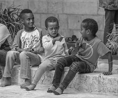 Who do you think, actually, did it? … (ybiberman) Tags: israel jerusalem oldcity alquds christianquarter churchoftheholysepulchre deirelsultan ethiopian portrait candid streetphotography documentary bw blackandwhite children boys playing offending bullying smiling accusing