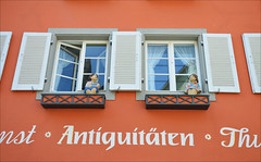 Antiquitäten (angelsgermain) Tags: house building windows shutters glass curtains windowsill dolls figures wall sign advertisement ad shop façade antiqüitaten street meersburg bodensee lakeconstance badenwürttenberg germany deutschland