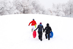 Heading up the Sledding Hill (aaronrhawkins) Tags: sledding sled snow hill snowing winter cold cool walk climb storm white covered family fun season jessica kellie joshua provo utah aaronhawkins