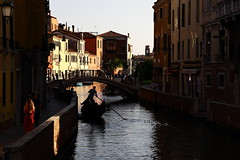 the red dress (°andre²a°) Tags: canon canoneosr venice channel water gondola people woman red sunset reflections city italy black street scene summer