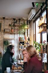 Negative0-30-30A(1) (simona_stoeva) Tags: paris travel fuji200 canonae1 canon film analogue analog 35mm negative france cafe interior people books shakespeareandco shakespeare cozy