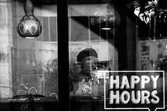 happy hours (radek_k_) Tags: street streetphoto inside woman streetphotography glass window urban urbanandstreet urbanphotography people blackandwhite bnw bw monochrome olympus omd mzuiko