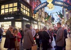 Carnaby Street (I M Roberts) Tags: carnabystreet soho christmaslights w1 centrallondon streetscene tourists fujix100s