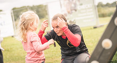 Proud of her mom's accomplishment. (Alex-de-Haas) Tags: 70200mm d5 dutch dutchies europa europe geestmerambacht holland langedijk majorobstaclerun nederland nederlands netherlands nikkor nikkor70200mm nikon nikond5 noordholland ocr bootcamp candid dirt dirty endurance evenement event fit fitdutchies fitness fun hardlopen joggen jogging mensen modder mud obstacle obstaclecourserace obstaclecourserun obstacleracing obstaclerun obstakel people race racing rennen renner renners run runner runners running sport sportief sportiviteit sporty summer team teamspirit teamgeest vies zomer noordscharwoude northholland
