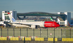 Gatwick North (Deepgreen2009) Tags: airport gatwick airliner aeroplane aircraft norwegian red boeing787 dreamliner bridge terminal north london taxiing transport flight