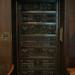 Heavy dark wood door