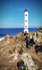 Farol de Cabo Home (vmribeiro.net) Tags: lighthouse outdoors sky nature sea water cliff summer landscape safety horizontal color image donón cangas galicia spain europe southern no people waters edge rock object day extreme terrain coastline nonurban scene scenics cabo home redminote7